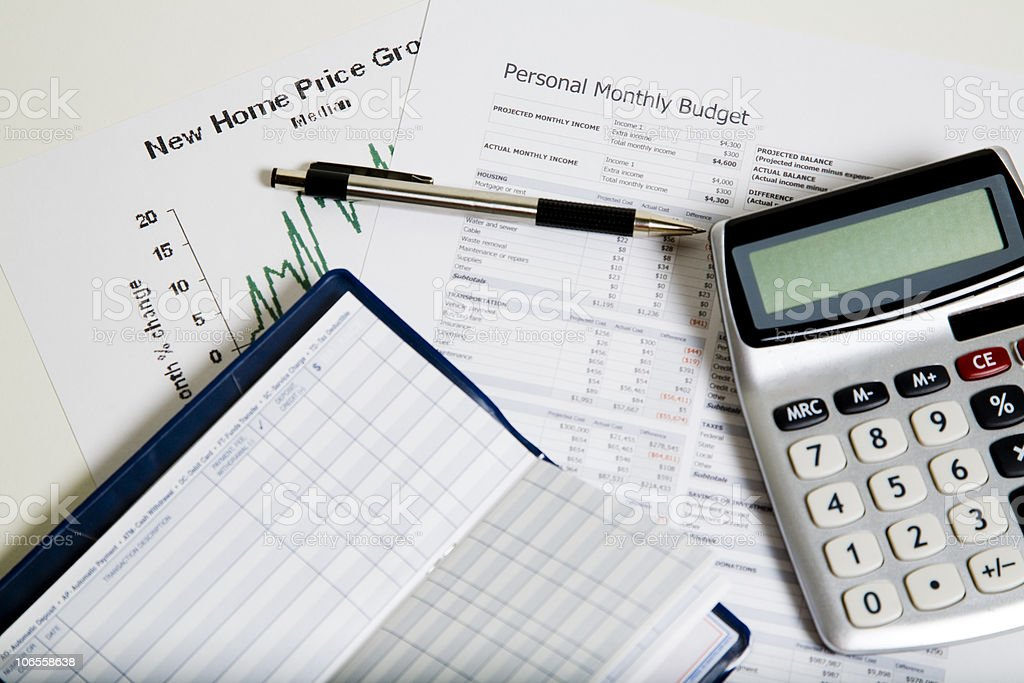Papers and a calculator to work out rising costs of living royalty-free stock photo