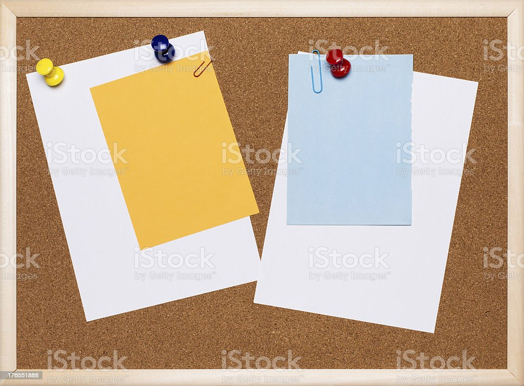 Papers on cork board royalty-free stock photo