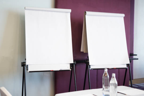 Papers realistic blank flipchart with legs on white paper background or roll up for presentation in meeting corporate training briefing or lecture classroom in university stock photo