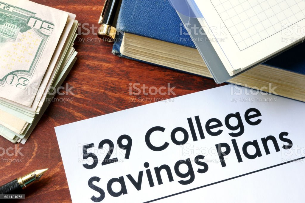 Papers with 529 College Savings Plans on a table. stock photo