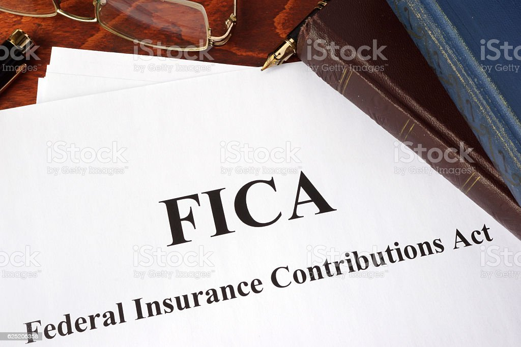 Papers with FICA Federal Insurance Contributions Act tax. stock photo