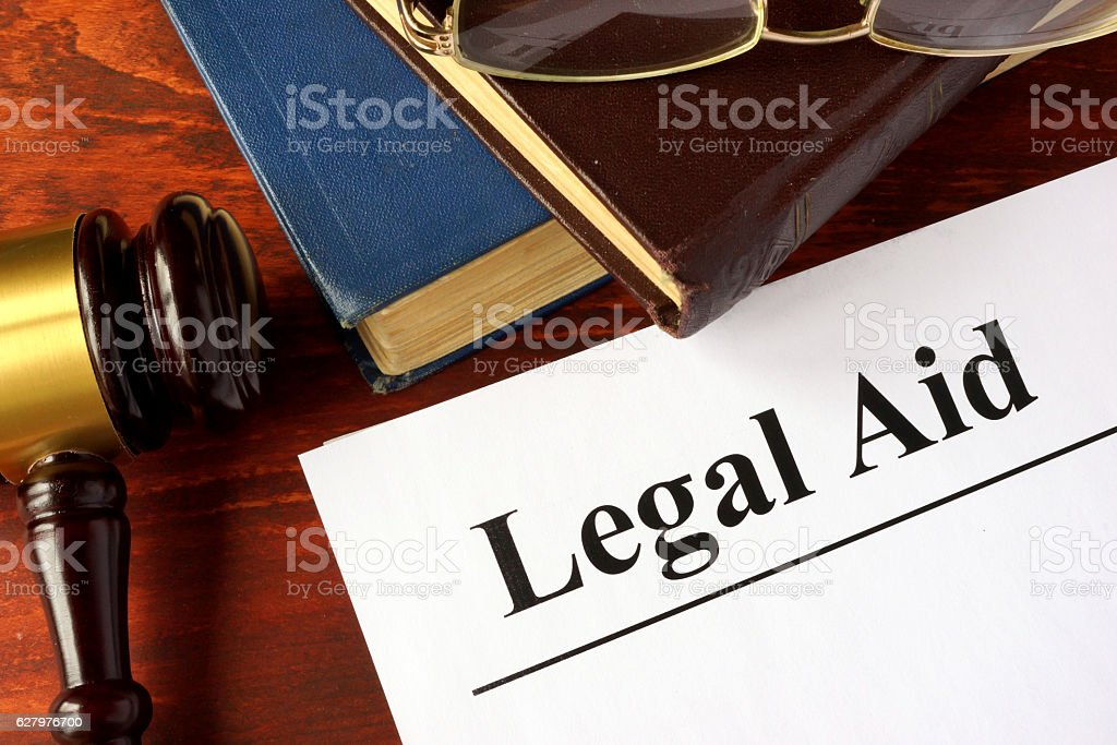 Papers with title legal aid on a table. - foto de acervo