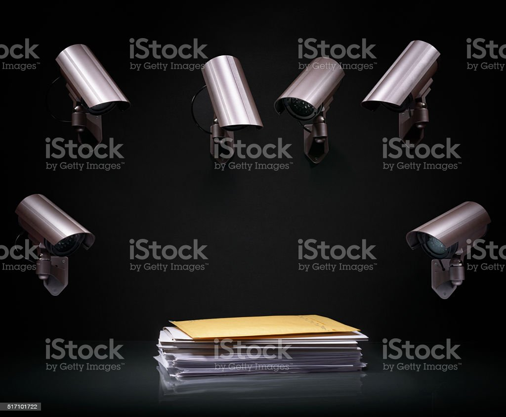 Paperwork stack under video surveillance stock photo