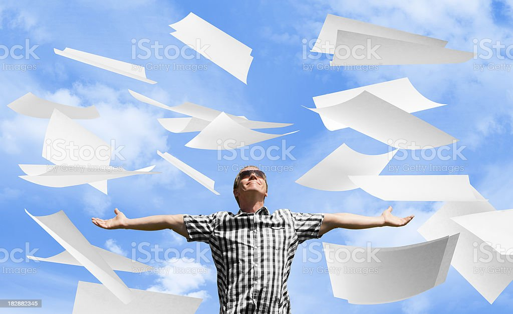 Paperwork thrown in air by man with arms outstretched stock photo