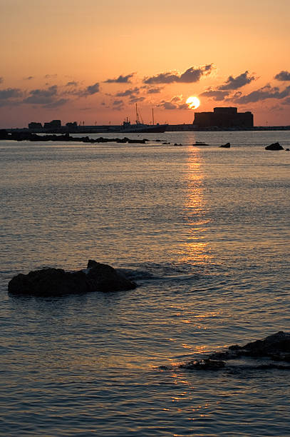 Paphos harbour at sunset stock photo