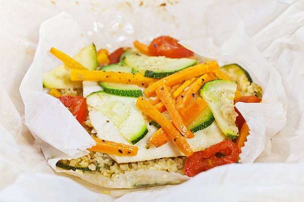 Papillote - hake fish prepared in a paper stock photo