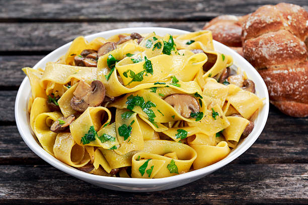 pappardelle pasta with mushrooms and other herbs - tagliatelle mushroom bildbanksfoton och bilder