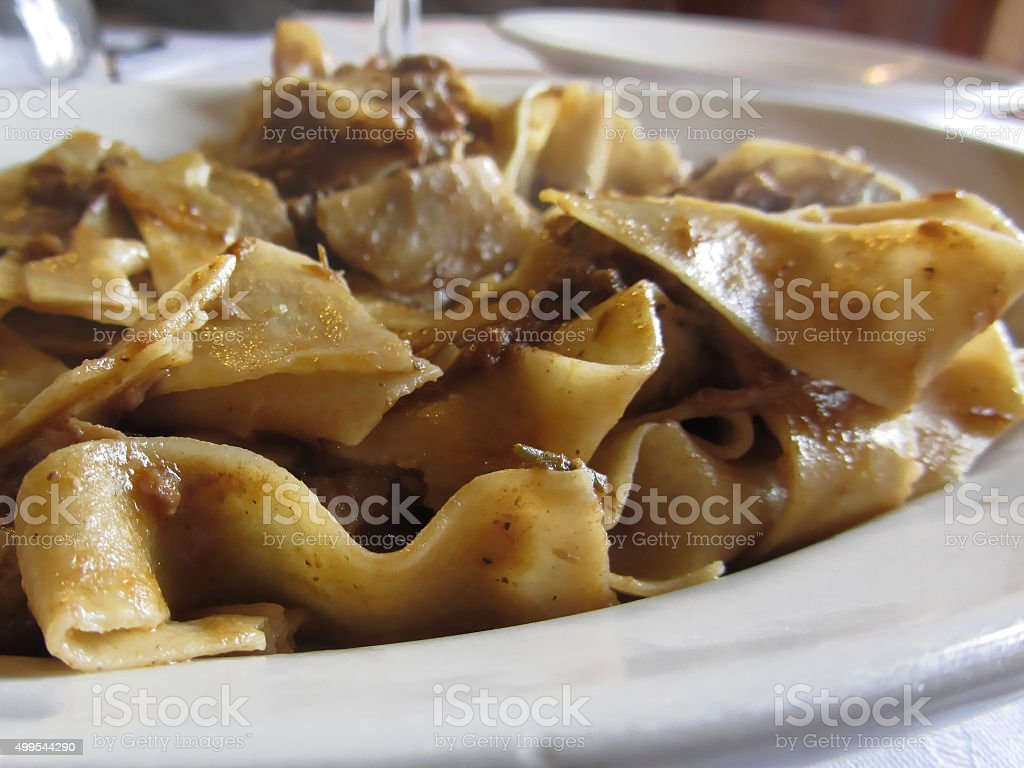 Pappardelle with boar ragu. Tuscan typical recipe of italian pasta stock photo