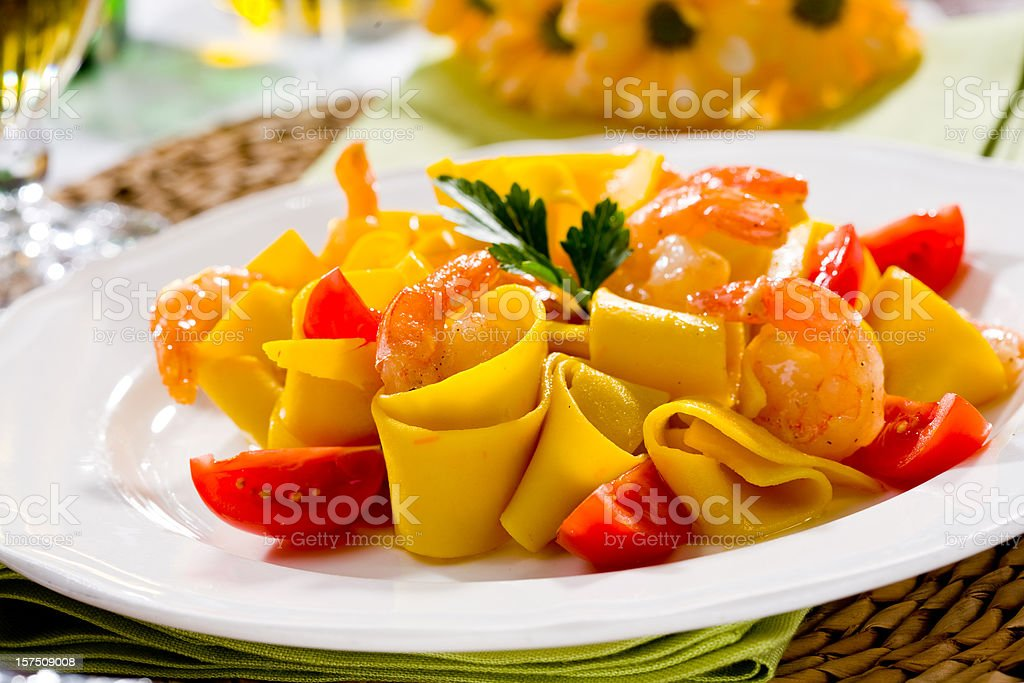 Pappardelle with fried prawn royalty-free stock photo
