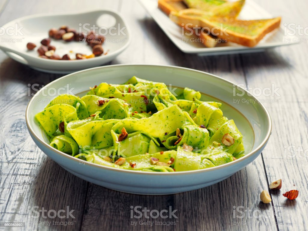 pappardelle with parsley butter and hazelnuts stock photo