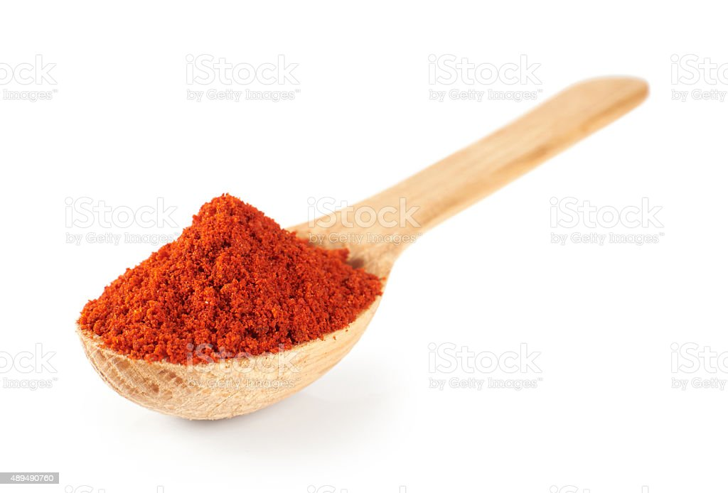 Paprika on a wooden spoon isolated on white background stock photo