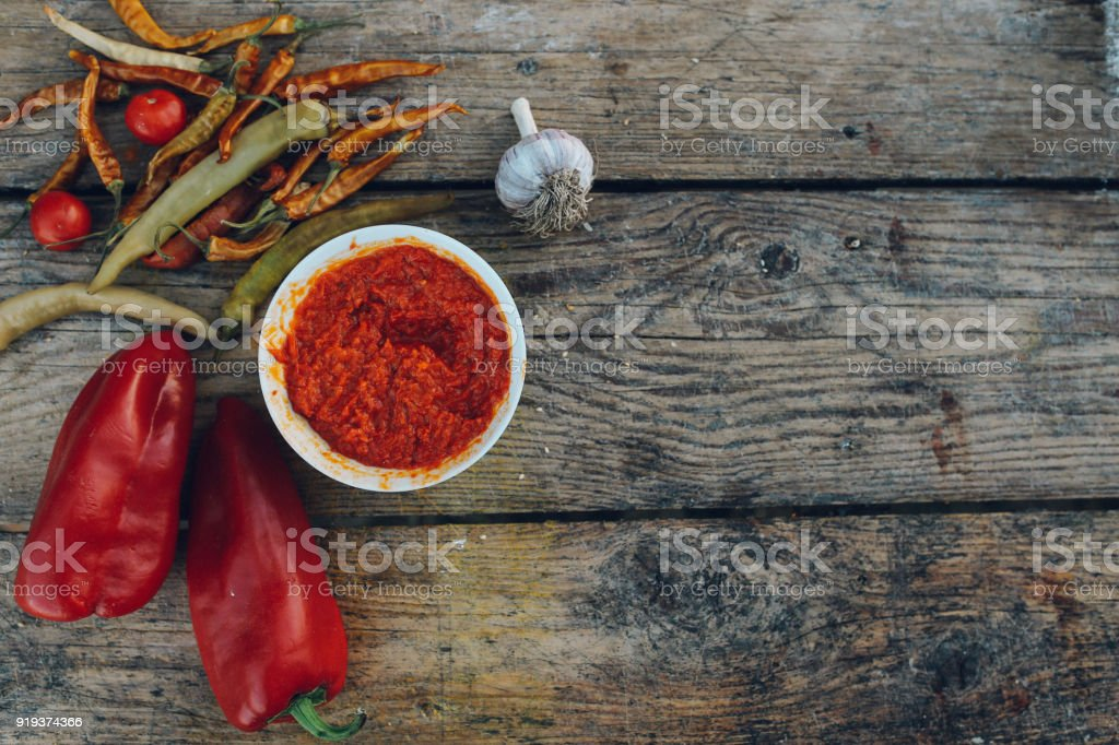 Paprika, onion, cherry tomatoes and spicy ajvar stock photo