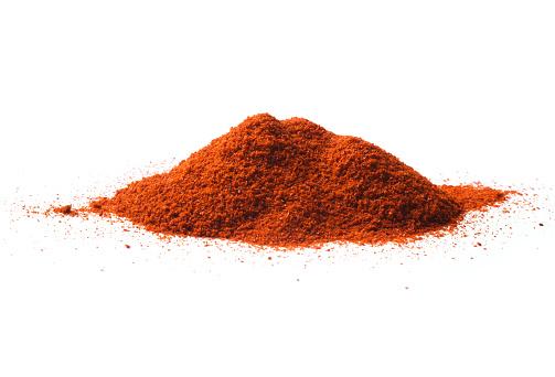 Paprika powder pile isolated on white background