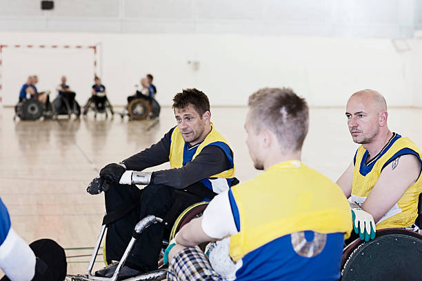 para rugby team talking during time-out - wheelchair sports stock photos and pictures