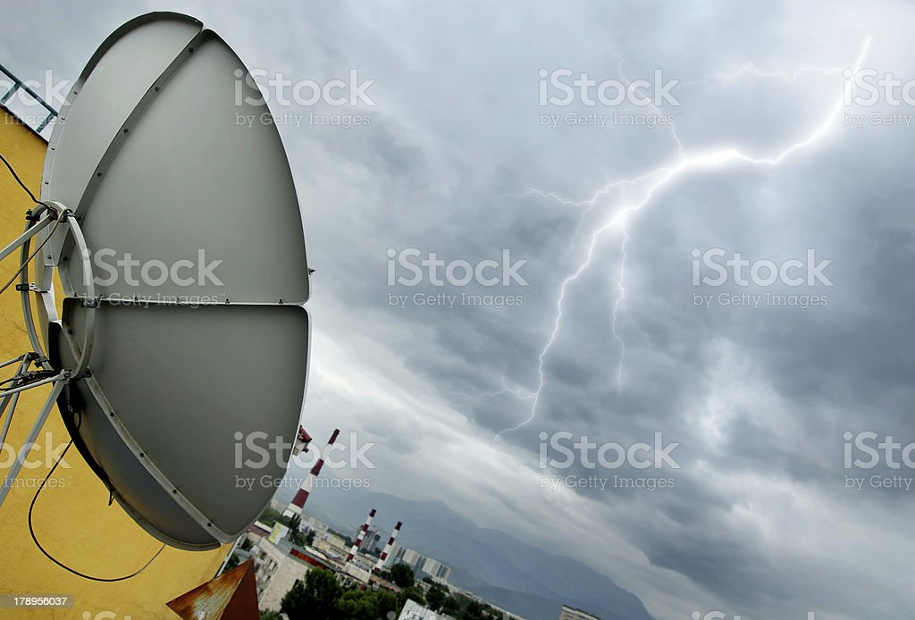 Parabolic antenna and lightning royalty-free stock photo