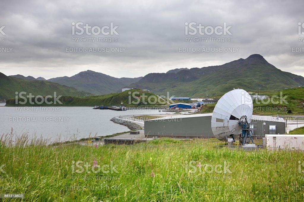 Parabolic antenna of the Unalaska Airport. stock photo