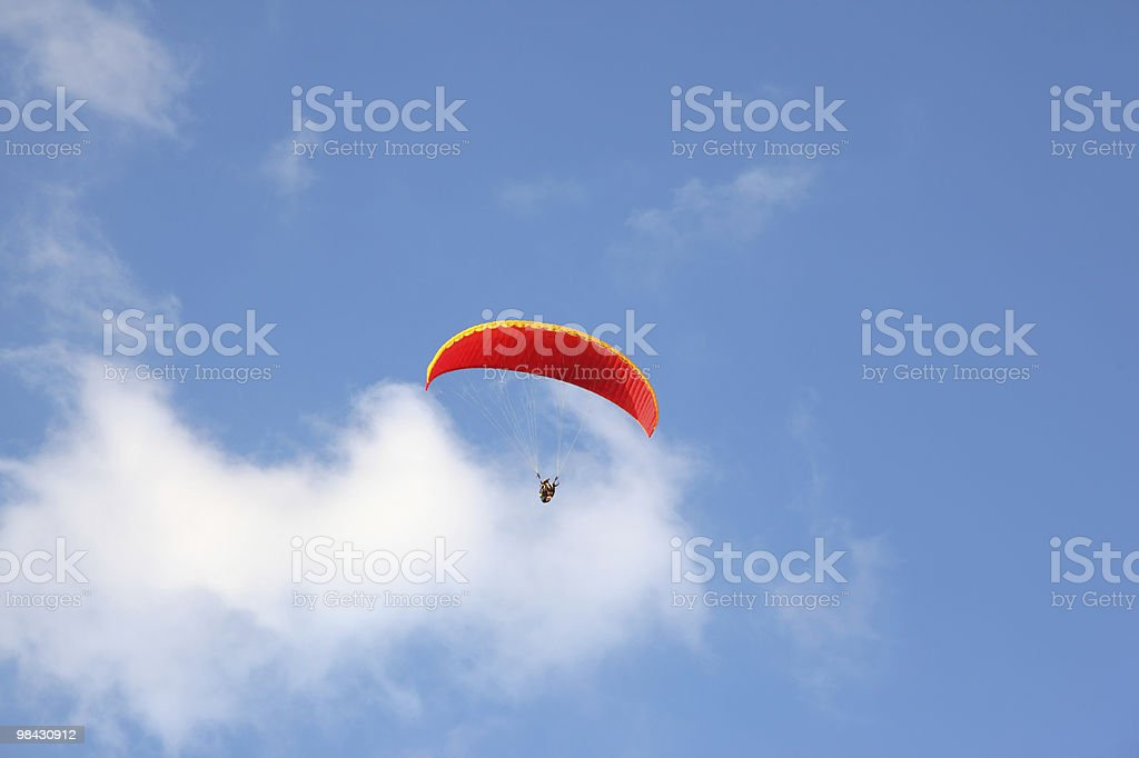 Parachute flies in the blue sky royalty-free stock photo