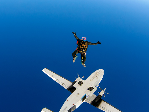 Parachute jump from an airplane in tandem with an instructor.