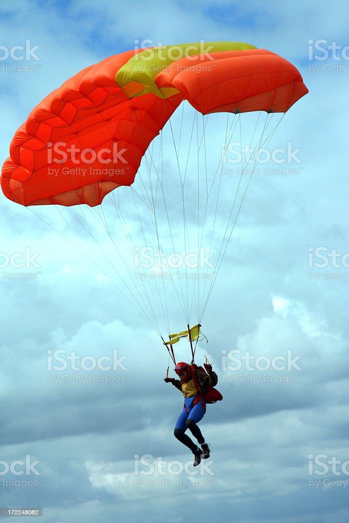 A parachute jumper preparing to land royalty-free stock photo
