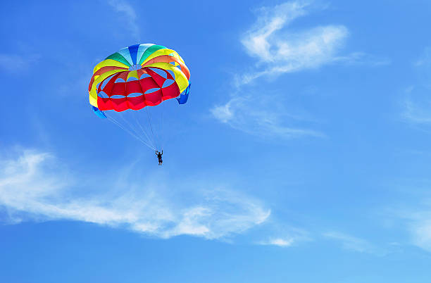 Parachute jumping. Parachute is in the sky, under the clouds. Parachute jumping. Colorful parachute is in the sky, under the clouds. Copy space. Empty place for message. Outdoor. Travel, freedom, adventure, success, business concept. parachuting stock pictures, royalty-free photos & images