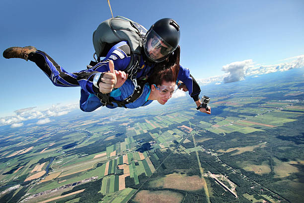 Parachute jumping Parachute jumping parachuting stock pictures, royalty-free photos & images