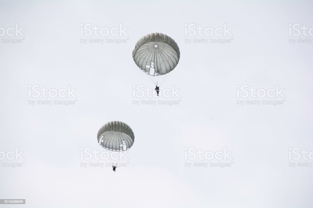 Parachute soldiers in the sky. stock photo