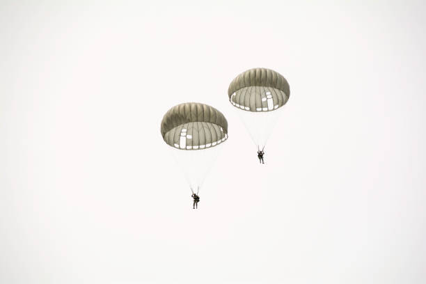 Parachute soldiers in the sky. Parachute soldiers in the sky. parachuting stock pictures, royalty-free photos & images