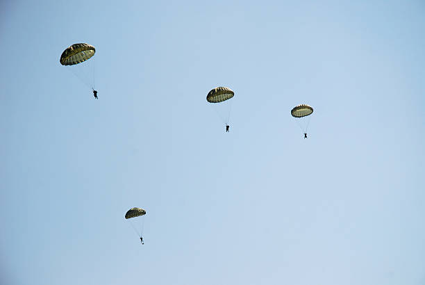 Parachute troopers Parachute troopers falling from the sky trooper stock pictures, royalty-free photos & images