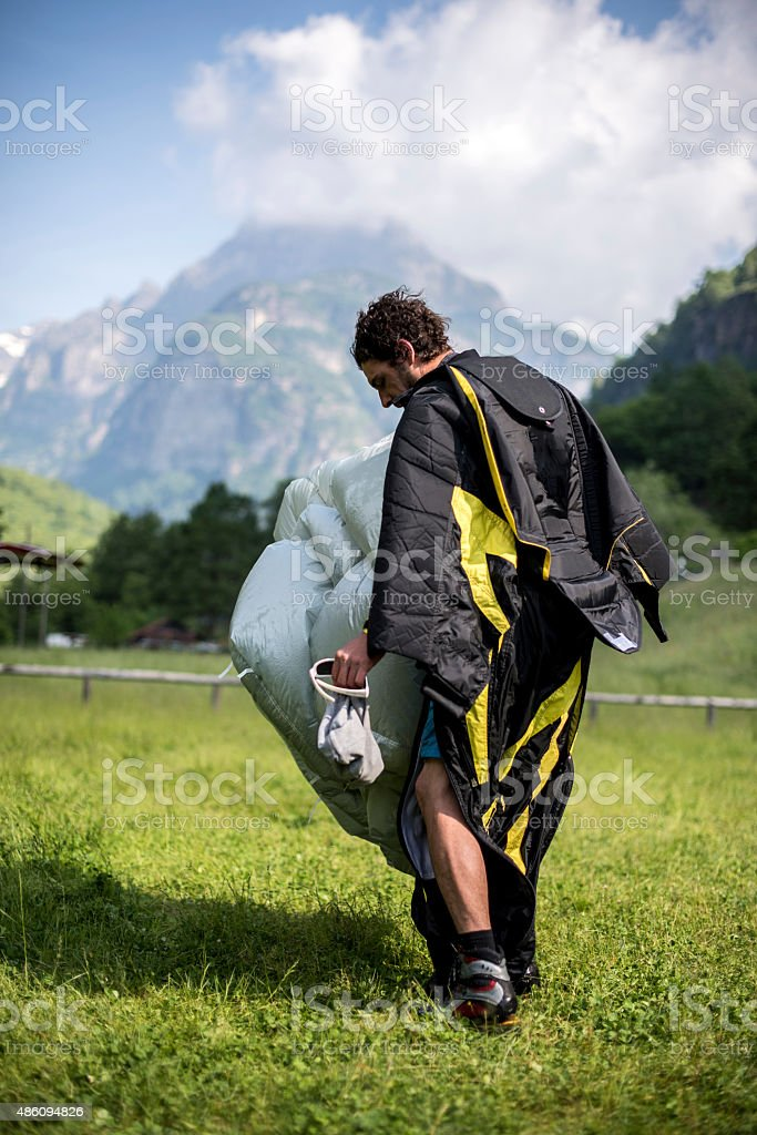 Parachuter after touch down in Bern Canton, Switzerland. stock photo