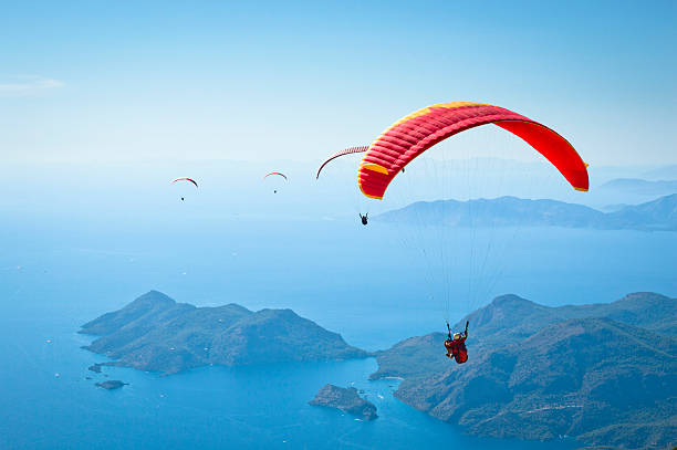 Parachuting Paragliding at Fethiye Oludeniz. parachuting stock pictures, royalty-free photos & images