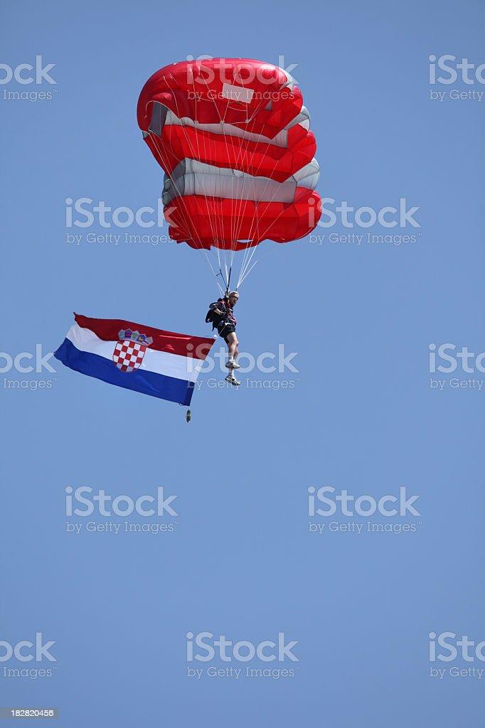 Parachutist carrying the Croatian flag royalty-free stock photo