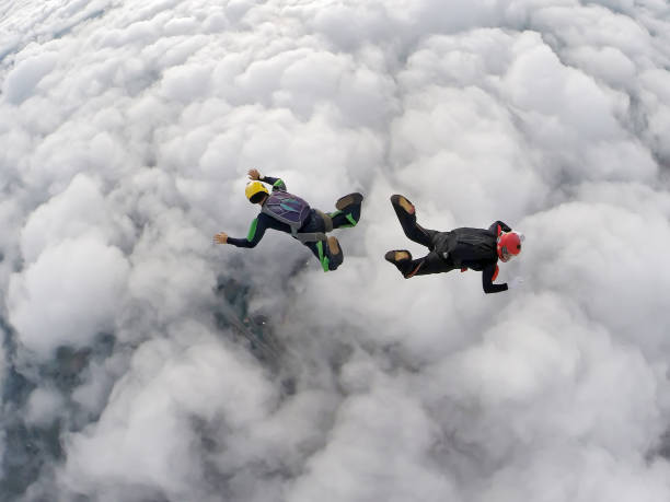 Parachutist couple separated from back to back. stock photo