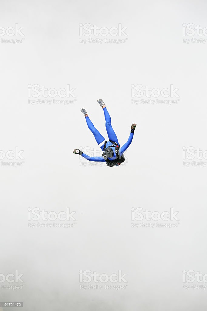 Parachutist in a cloud royalty-free stock photo