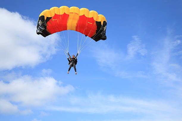 Parachutist in air Parachutist in air parachuting stock pictures, royalty-free photos & images