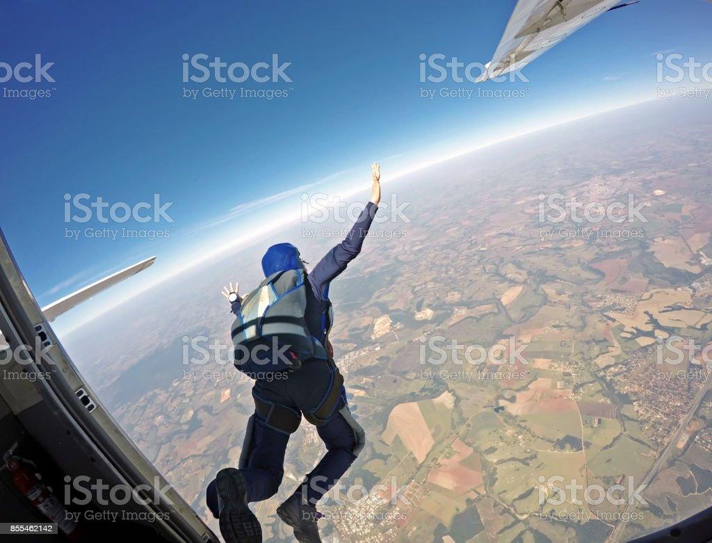 Parachutist jump from the plane. stock photo