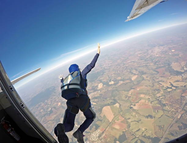 Parachutist jump from the plane. stock photo