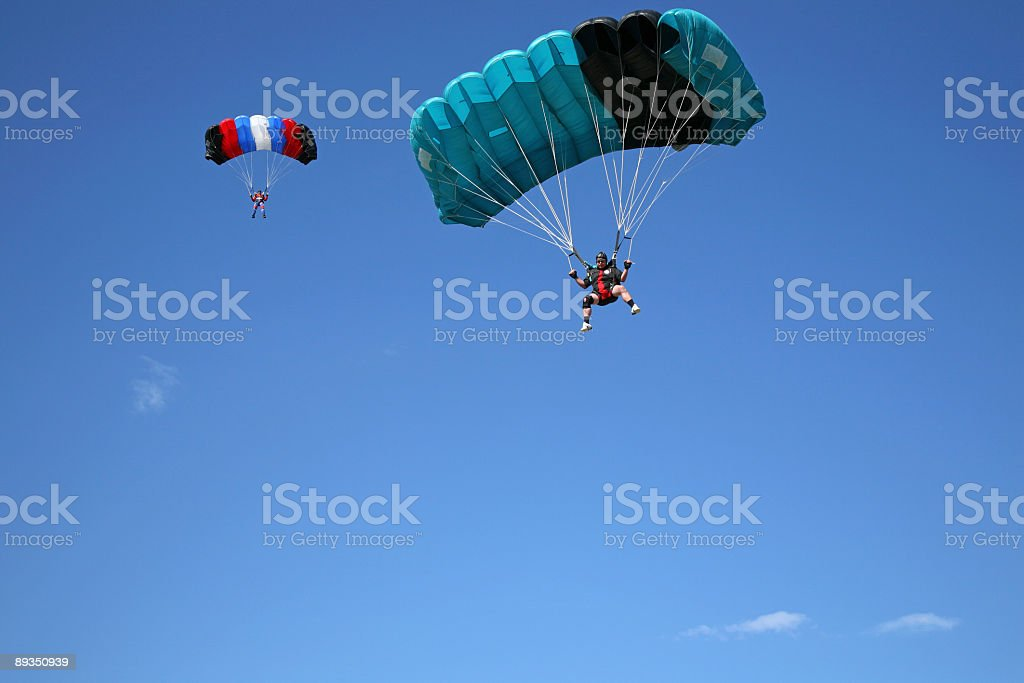 Parachutists on the blue sky-Losinj Island-Croatia royalty-free stock photo