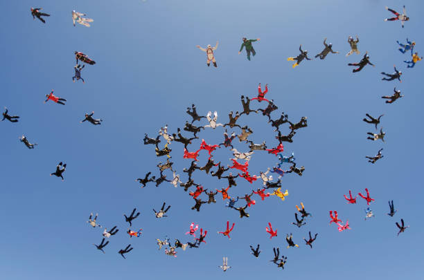 Parachutists starting the take off after the jump. stock photo