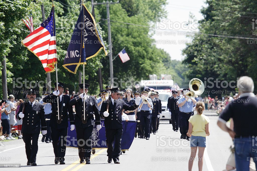 Parade Fireman Marching Waving to Spectators July 4th stock photo