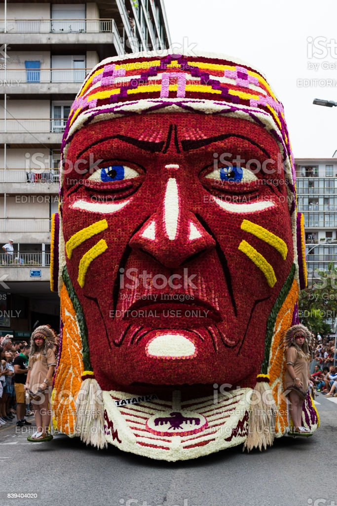 Parade of floats with Indian faced stock photo