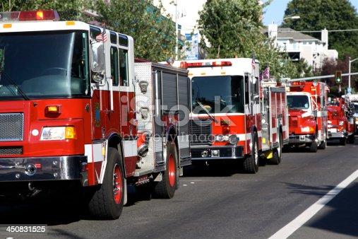Parade of modern firetrucks