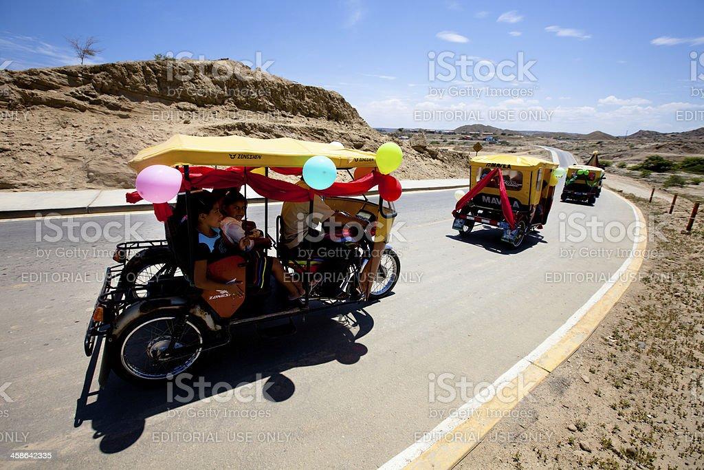 "Parade of motorcycle (""motos"") taxis in rural Peru royalty-free stock photo"