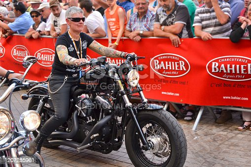 LE MANS, FRANCE - JUNE 13, 2014:Parade of pilots racing. Old women on motorcycle in Le Mans, France.