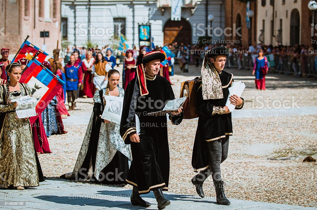 parade of two notary in historical costumes stock photo