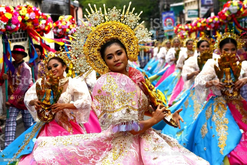 Parade participants in their colorful costumes stock photo