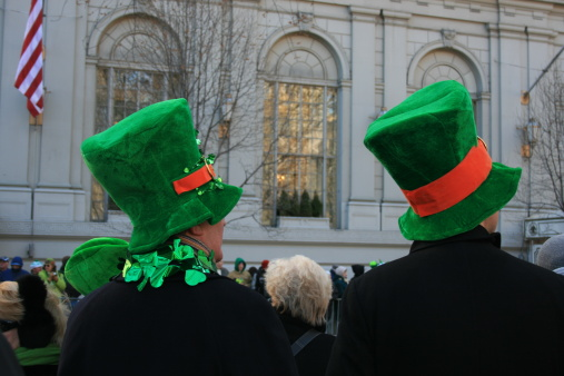 Two men is novelty hats watching the St. Patricks Day Parde in Manhattan.