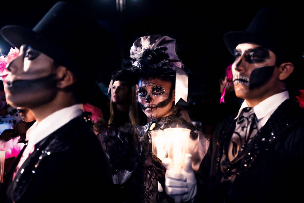 Parade with costumed caterinas for dia de los muertos, Merida, Mexico stock photo