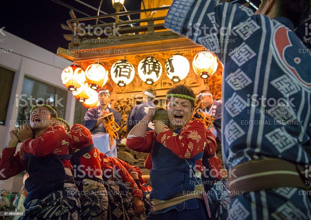 Parading with huge festival float - Sawara Autumn Festival stock photo