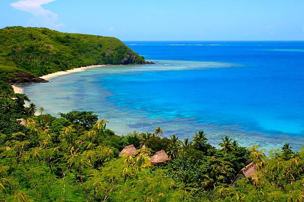 paradise: above fiji yasawa islands, deserted turquoise beach and palapas - fiji stock photos and pictures