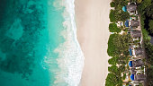 Paradise Beach and Waves from above drone shot aerial view of Resort